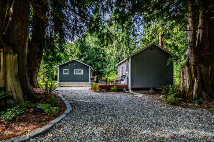 3. Not only is this tiny home in Concrete comfy, but it comes with a gorgeous small guest cabin!