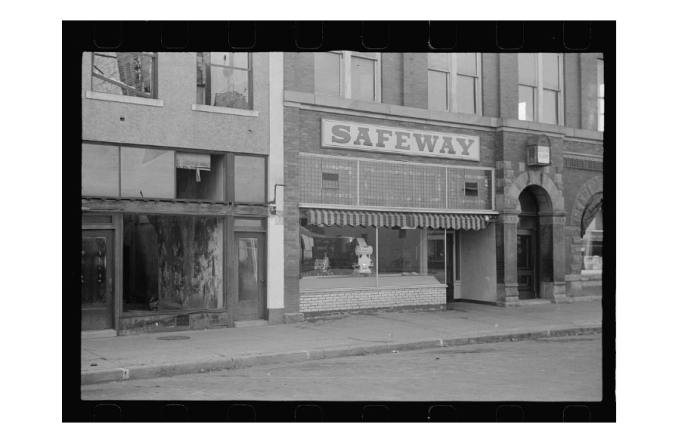16. Shops on Main Street in Wymore, 1938.