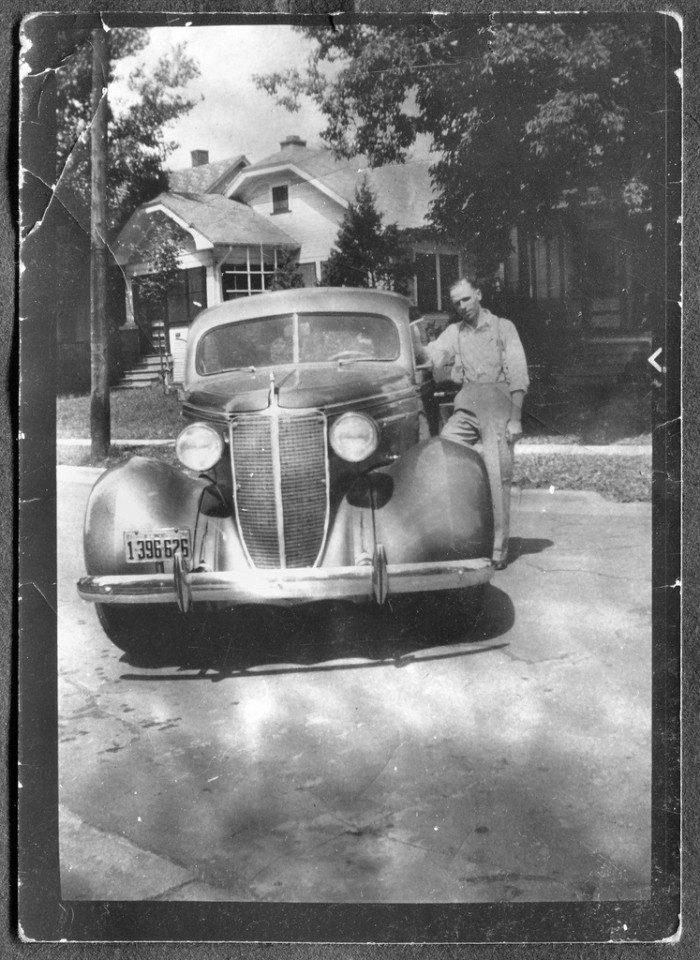 5. This Wisconsin man is proud of his automobile.