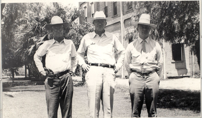 1. Here's an image of a few police officers in the 1930s. They sure dressed differently!