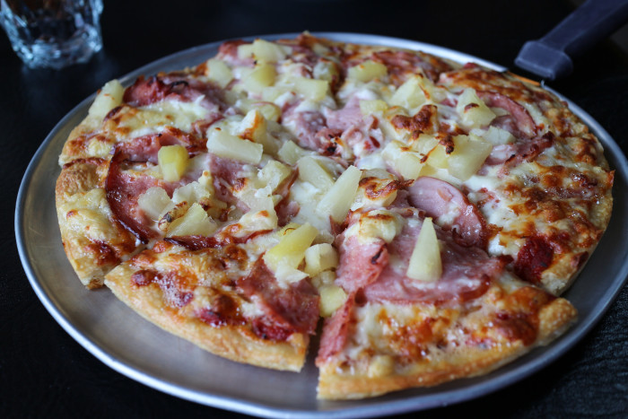 11) Adding ham and pineapple to a pizza doesn't make it Hawaiian.