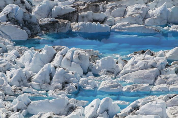 12) Crystal blue glacier waters.