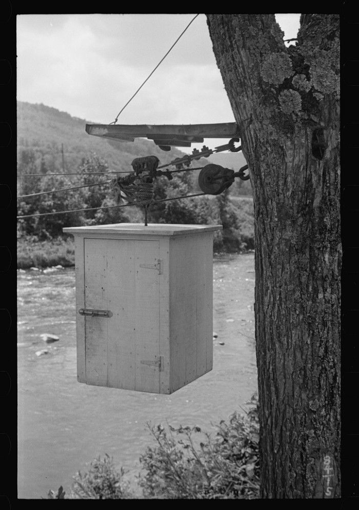 11.  Near Woodstock, Vermont, mail box on pulley for people who live across the creek.