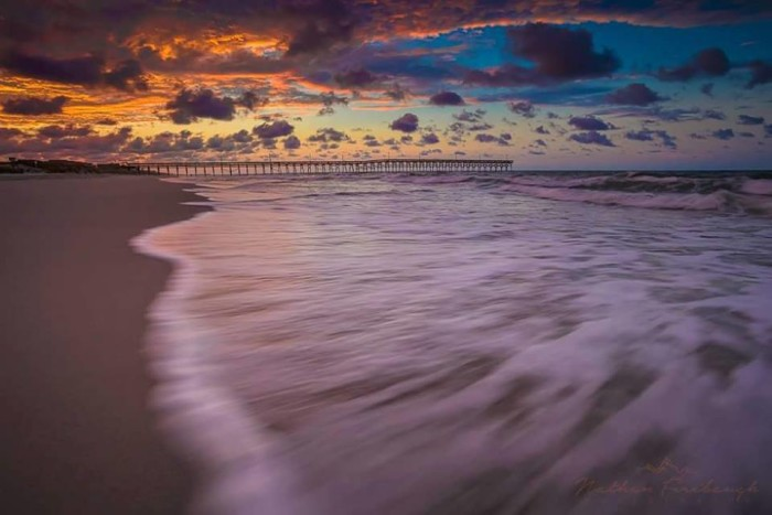 9. Gorgeous sunrise and rushing water at Holden Beach by Nathan Firebaugh Photography.