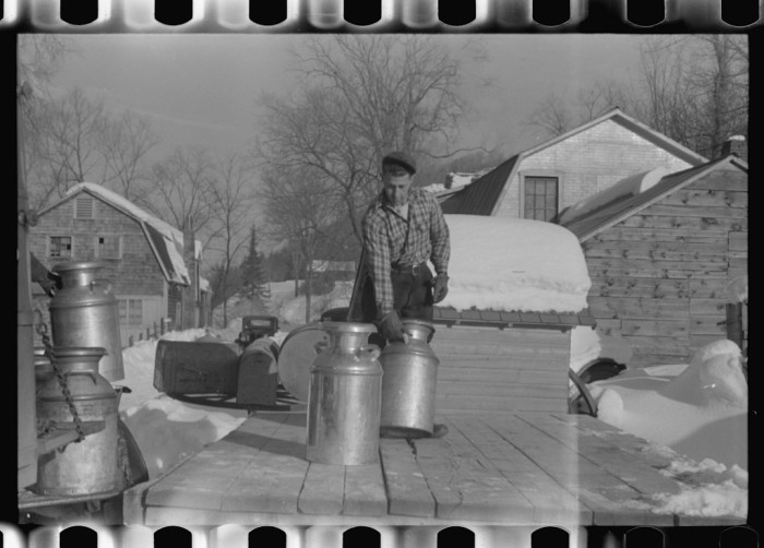 10.  Farmers near Woodstock, Vermont bring their cans of milk to the crossroads early every morning where it is picked up by the coop farmers' truck and is taken to the city.