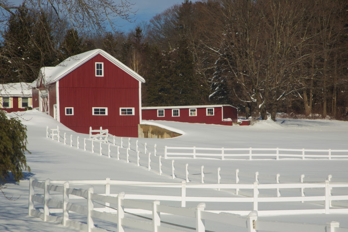 9. A white winter blanket in Springfield. There's something about snow on a red barn that just feels perfectly New England.