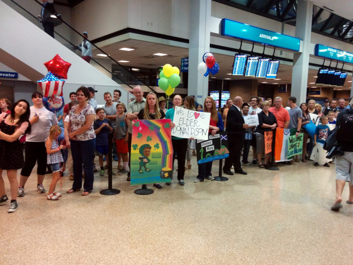 7. We welcome some world travelers home with banners and signs.