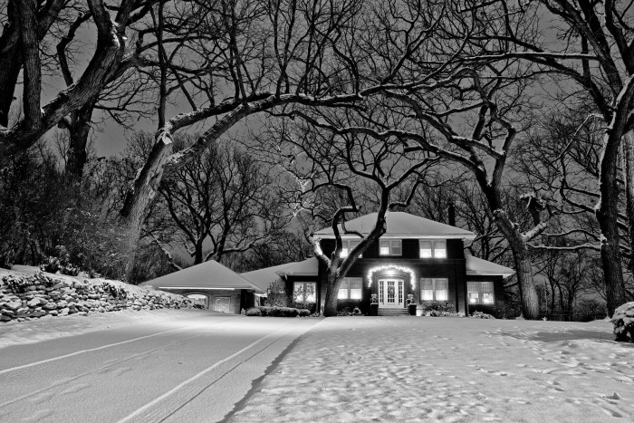 23. A cozy-looking home is so inviting in its snowy surroundings.