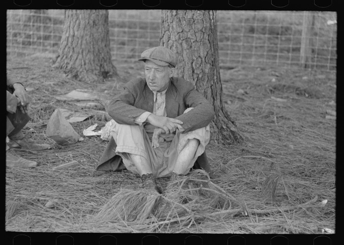 15. A migrant worker takes a roadside break in Hancock County.