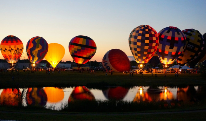 2) Witness the launching of hot air balloons at the Grand Rapids Balloon Festival.