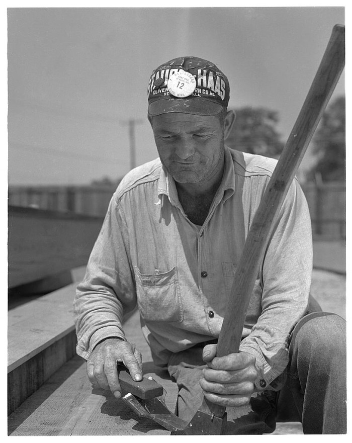 16. Taken in Biloxi, a local man is given the role of creating keels and other vital parts for submarine chasers.