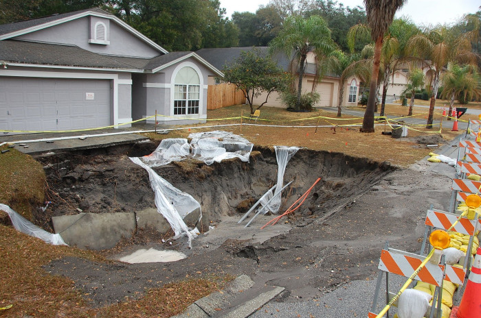 2. A giant sinkhole will swallow the whole thing.