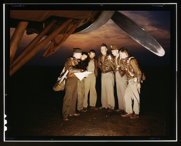 24. A bombardment squadron waits next to a YB-17 bomber while awaiting instructions at Langley Field in Hampton, May 1942.