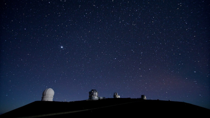 2) While stargazing at the summit of Mauna Kea.