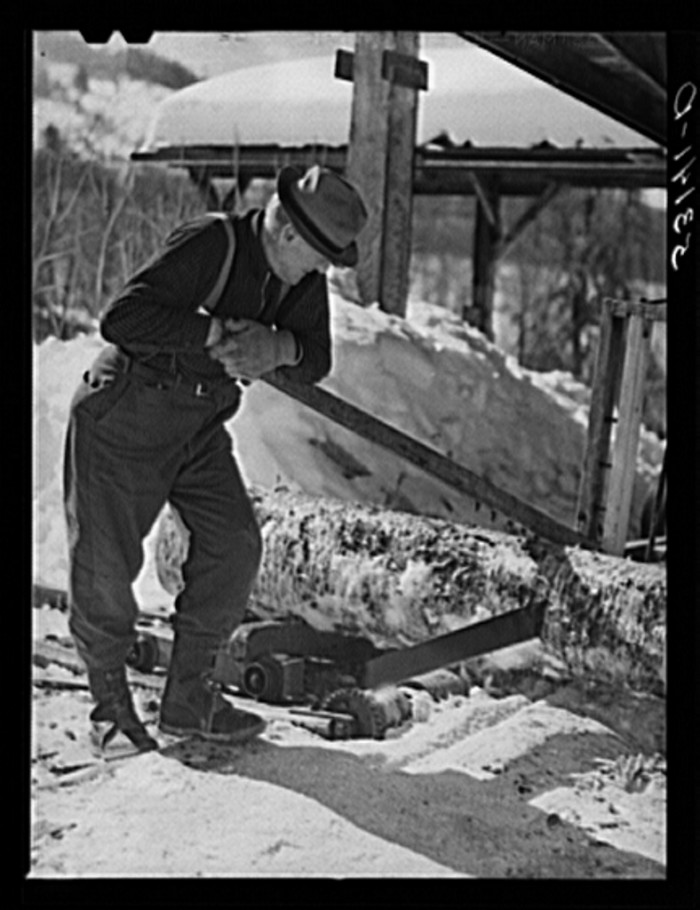 17.  Sawing wood on farm. Woodstock, Vermont.