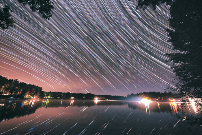 14. A long exposure helps illustrate the movement of the earth in its rotation. These stars work to illuminate a lake in Shapleigh.