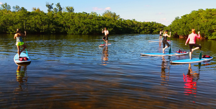 25) Learn how to stand up paddleboard. Or, if you're already a master, take a SUP yoga class.