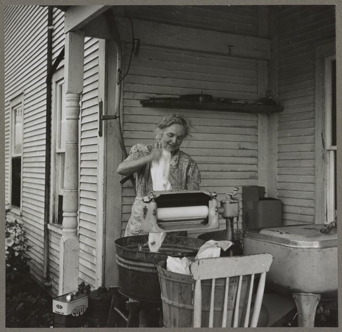 21.  Farm woman washing clothes in her motor-driven washing machine. Near Lincoln, Vermont.