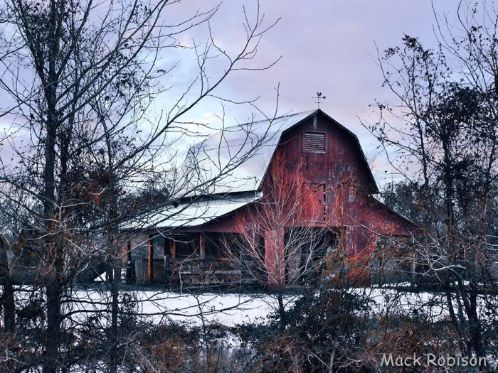 2. A blanket of snow proves to be an ideal addition to this picture-perfect barn in Panola County.