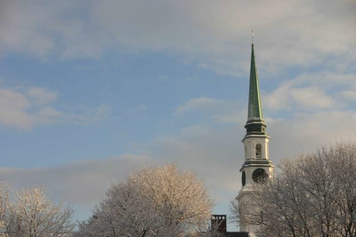 16. Snow covered trees perfectly match this steeple in Bangor.