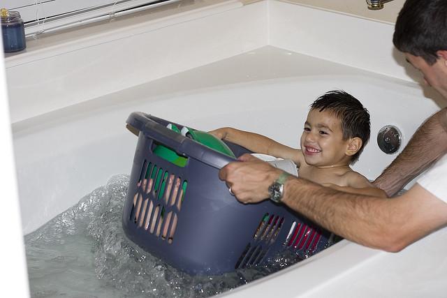4. Laundry basket in bathtub.
