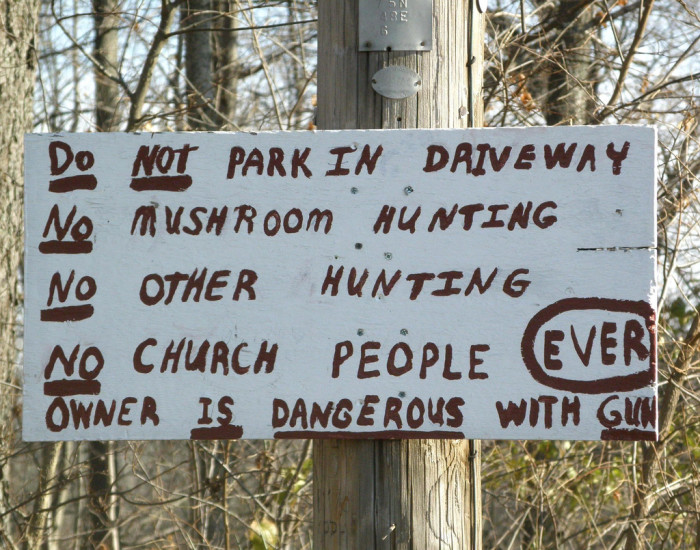 6. It is debatable whether this sign is funny or scary... Apparently this sign was located near the entrance of Mays Cemetery.