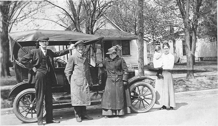 3. Two couples pose near their car in Lamoille, a tiny town near Marshalltown.