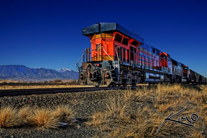 "2. ""Train and Rocky Mountains Colorado."""