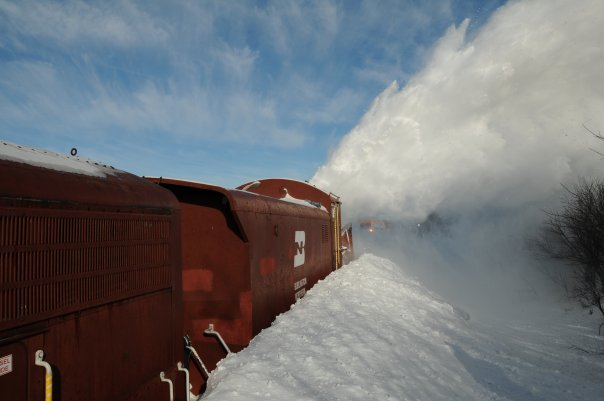 9. Blizzards in late 2009/early 2010 covered the railroad tracks near David City with 6-12 foot drifts of snow. A rotary snow plow was sent to retrieve a snowed-in freight train - and it made for a very unusual picture!