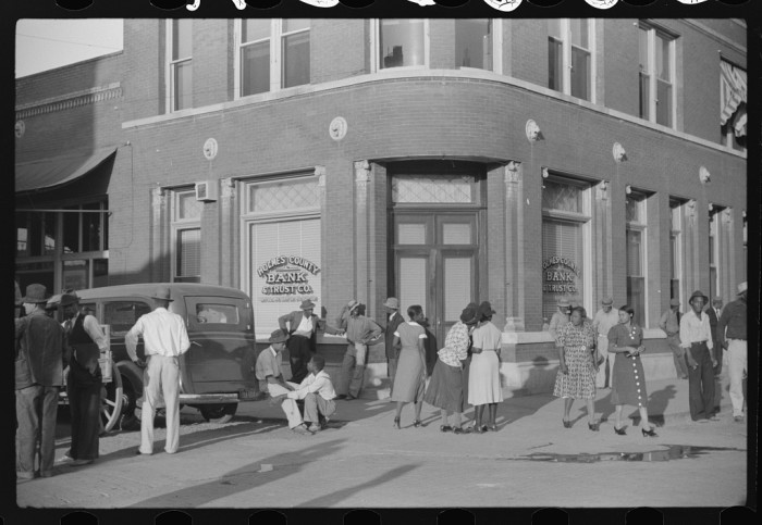 5. Lexington residents spend a weekend afternoon interacting in front of a local bank, which probably experienced a business boom during the war as the state's economy was very strong at that time.