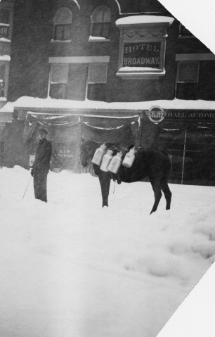 3. Pictured is a milkman walking in front of the Broadway Hotel on Broadway and 15th.