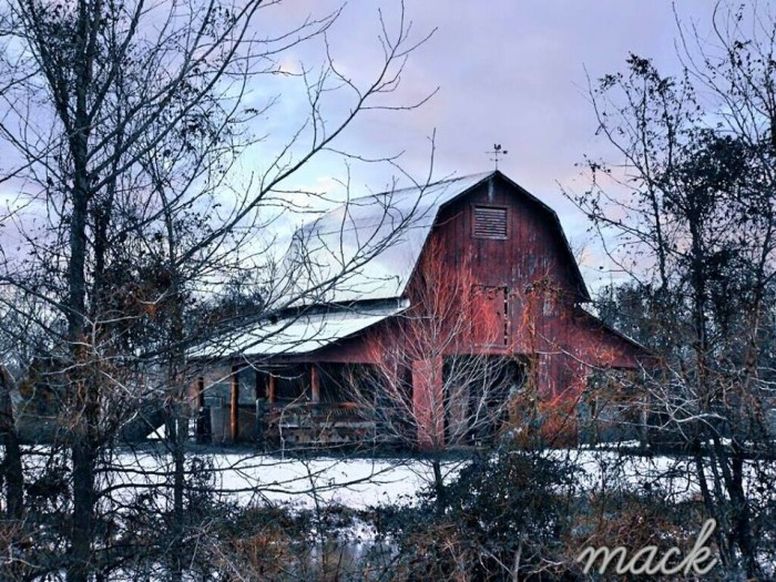 7. A quintessential red barn looks so seasonal when the ground is covered in snow.