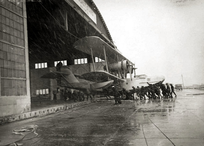 17. Ground personnel push a Hall PH-2 flying boat into a hangar at Coast Guard Air Station, Cape May.