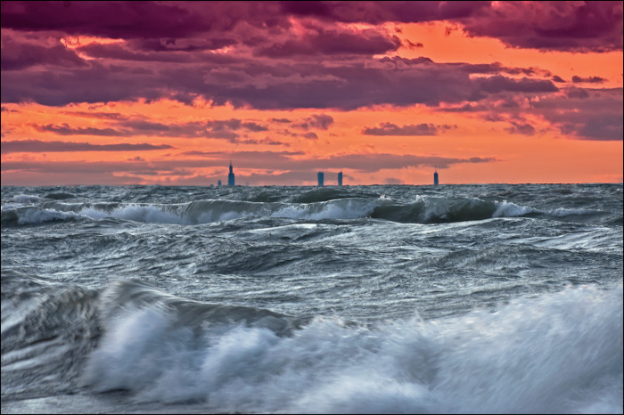 11. The Chicago skyline obstructed by the high waves of Lake Michigan. Moments after sunset, the sky took on an odd orange color, while the waters remained aqua green. Indiana Dunes National Lakeshore.