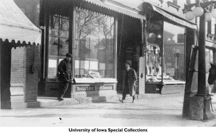 11. A view from the street shows Brown's Smoke House and the Iowa Book Store in Iowa City around 1915.