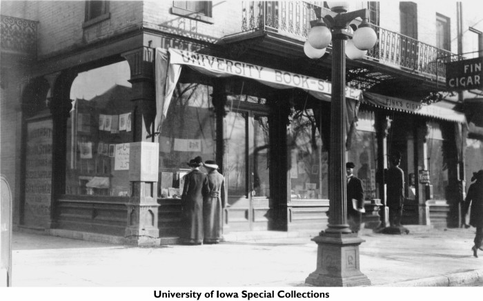 12. Two women window shop at University Book Store in Iowa City sometime in 1915.