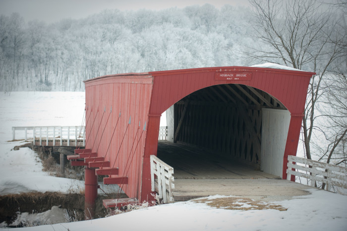 7. The bright red Hogback Bridge in Madison County is absolutely radiant against a dusting of white snow.