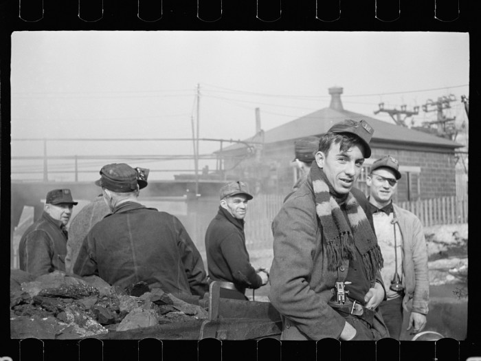 6. A group of miners in Mount Pleasant prepares to go underground.