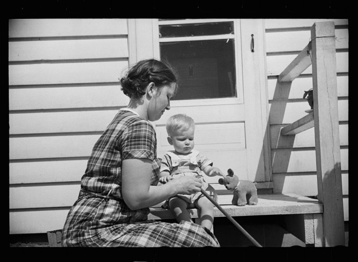 1. Here is a mother and her child on a homestead in Decatur, Indiana.