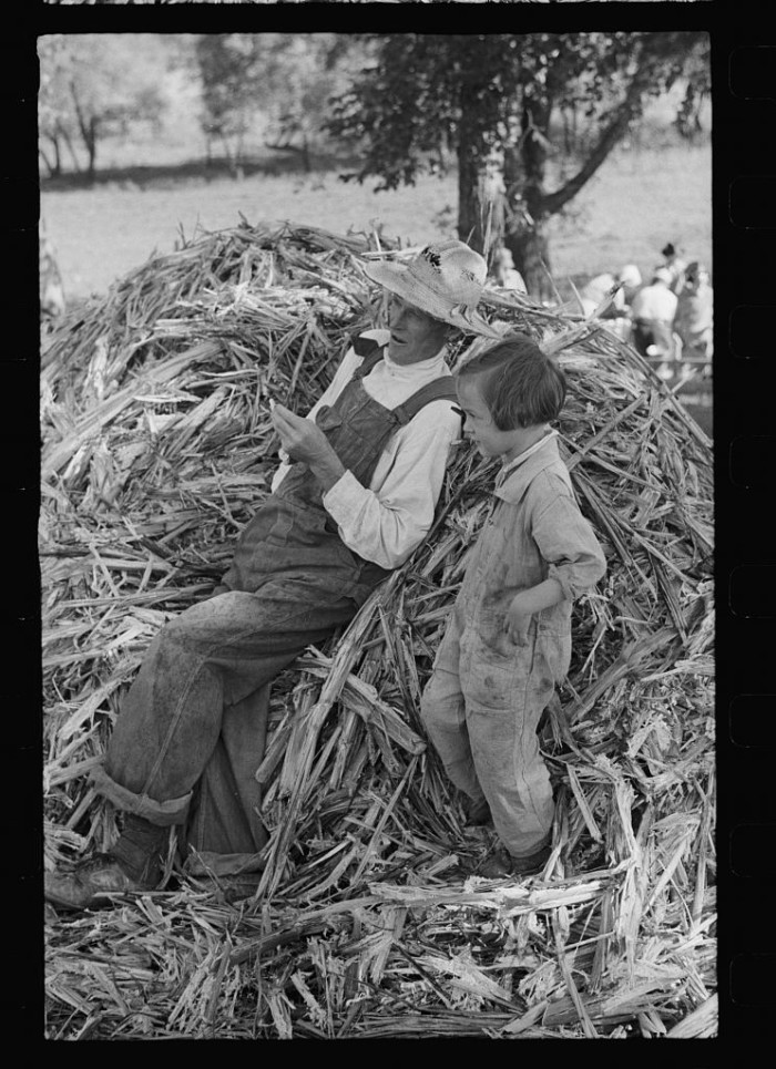 4. A farmer and a child relax for a moment.