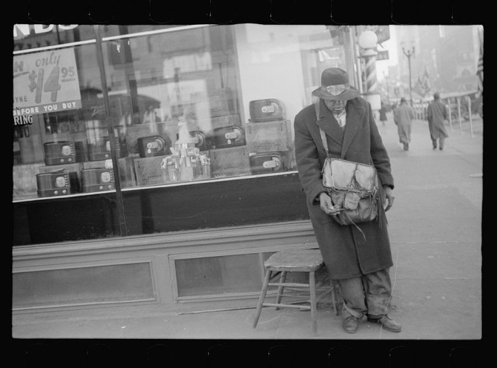 12. A blind man loiters in downtown Omaha.
