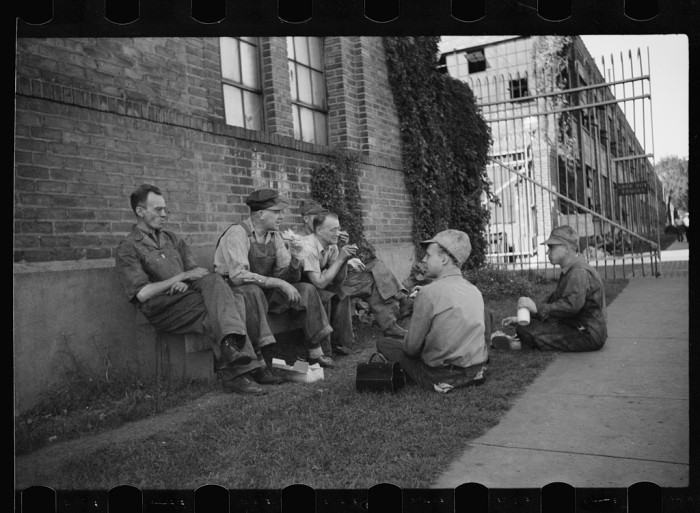 8. Men resting during their lunch hour at a tractor factory in Minneapolis in 1939.