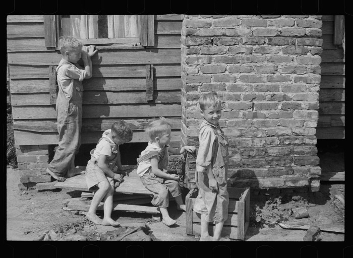 9. Children of resettled farmer who has been moved into a new house, Wolf Creek Farms, Grady County, Georgia - August 1935