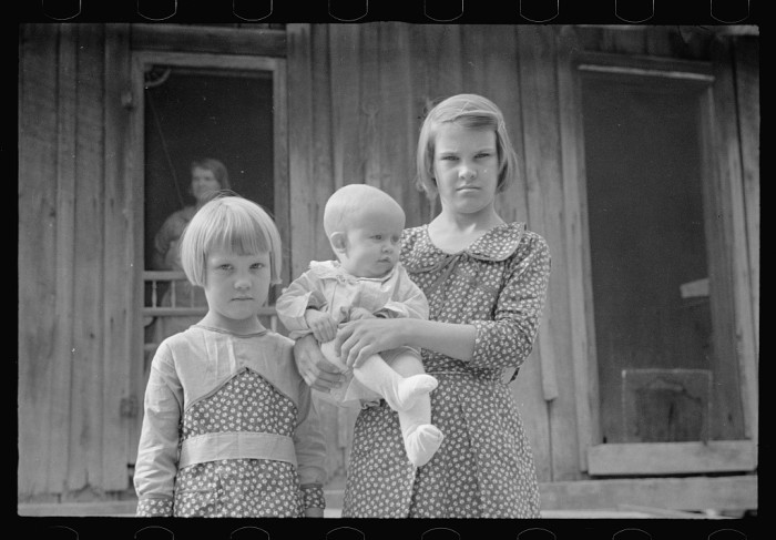 8. These are the same children from the family in the previous picture. They don't look so happy to be getting their pictures taken!