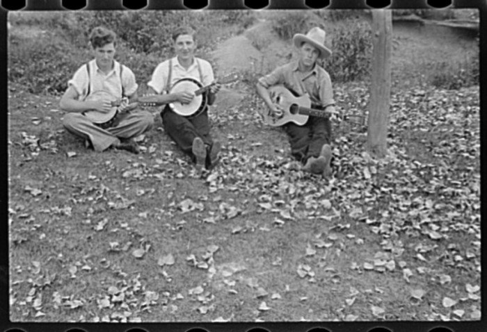 10. Some guys relax and play instruments together.
