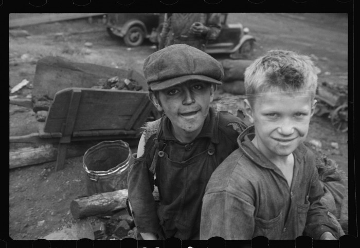 10. These boys are busy salvaging coal from slag heaps at Nanty Glo.