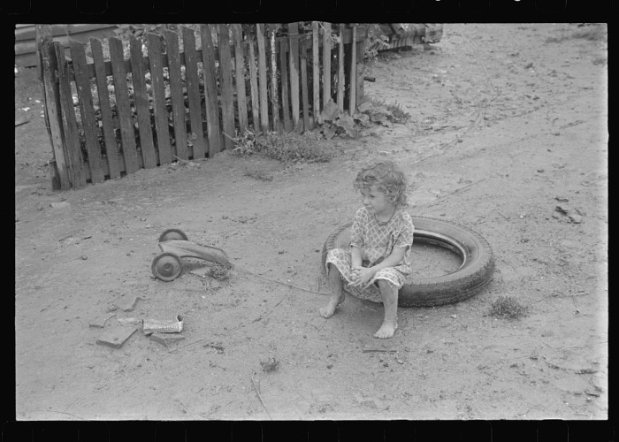 "13. Child playing in Circelville's ""Hooverville"""