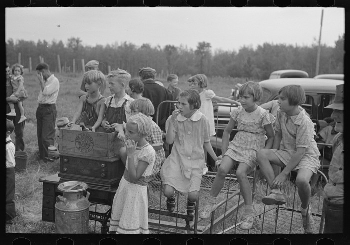 13. This group of children  is watching the 1937 S.W. Sparlin sale in Orth.