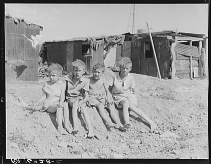 17. Sitting outside their Casa Grande home, these children were part of a family of eight from Oklahoma that found work in Arizona cotton fields (1937).