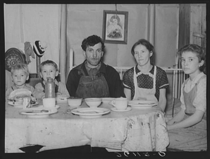 13. A family gathers around their table for dinner in Bedford County.